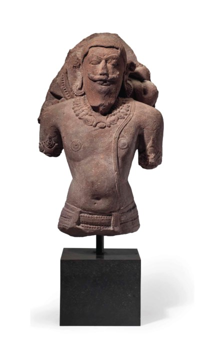A red sandstone bust of a deit