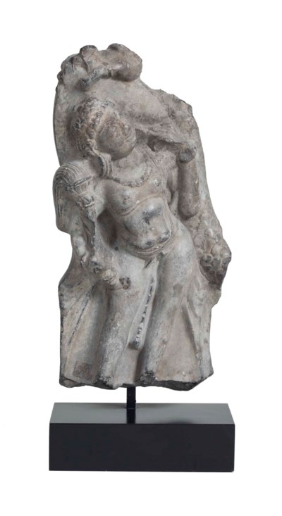 A stone figure of an attendant