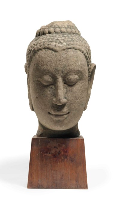 A sandstone head of Buddha