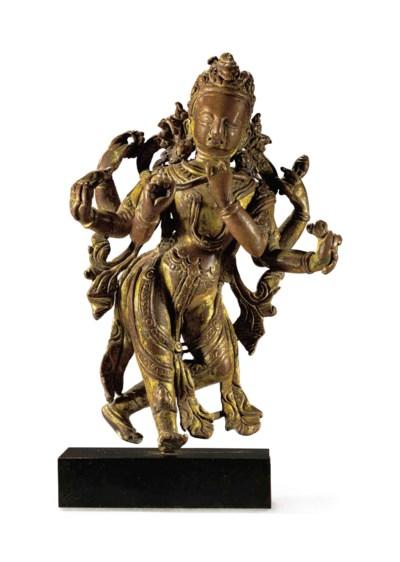 A gilt copper figure of Krishn