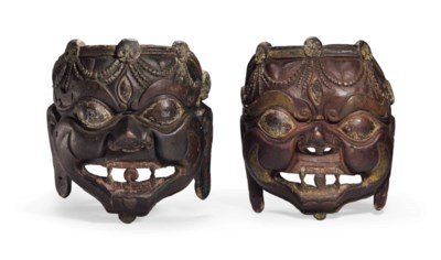 A pair of painted wooden masks