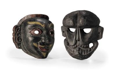 A pair of wooden grotesque mas
