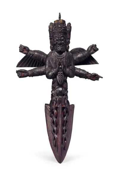 A wooden Vajrakila purbha