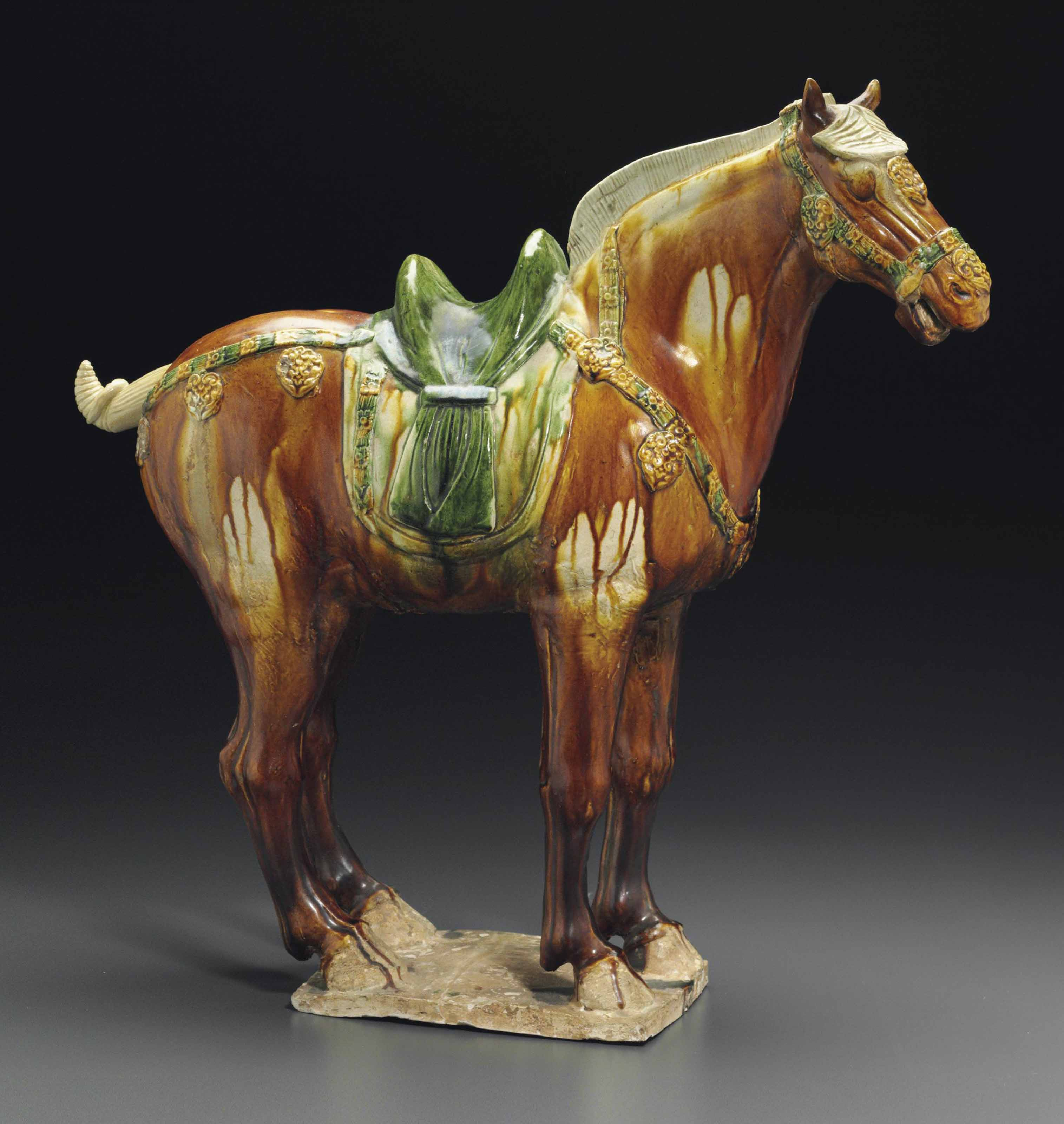 A SANCAI-GLAZED POTTERY FIGURE OF A HORSE | TANG DYNASTY (AD