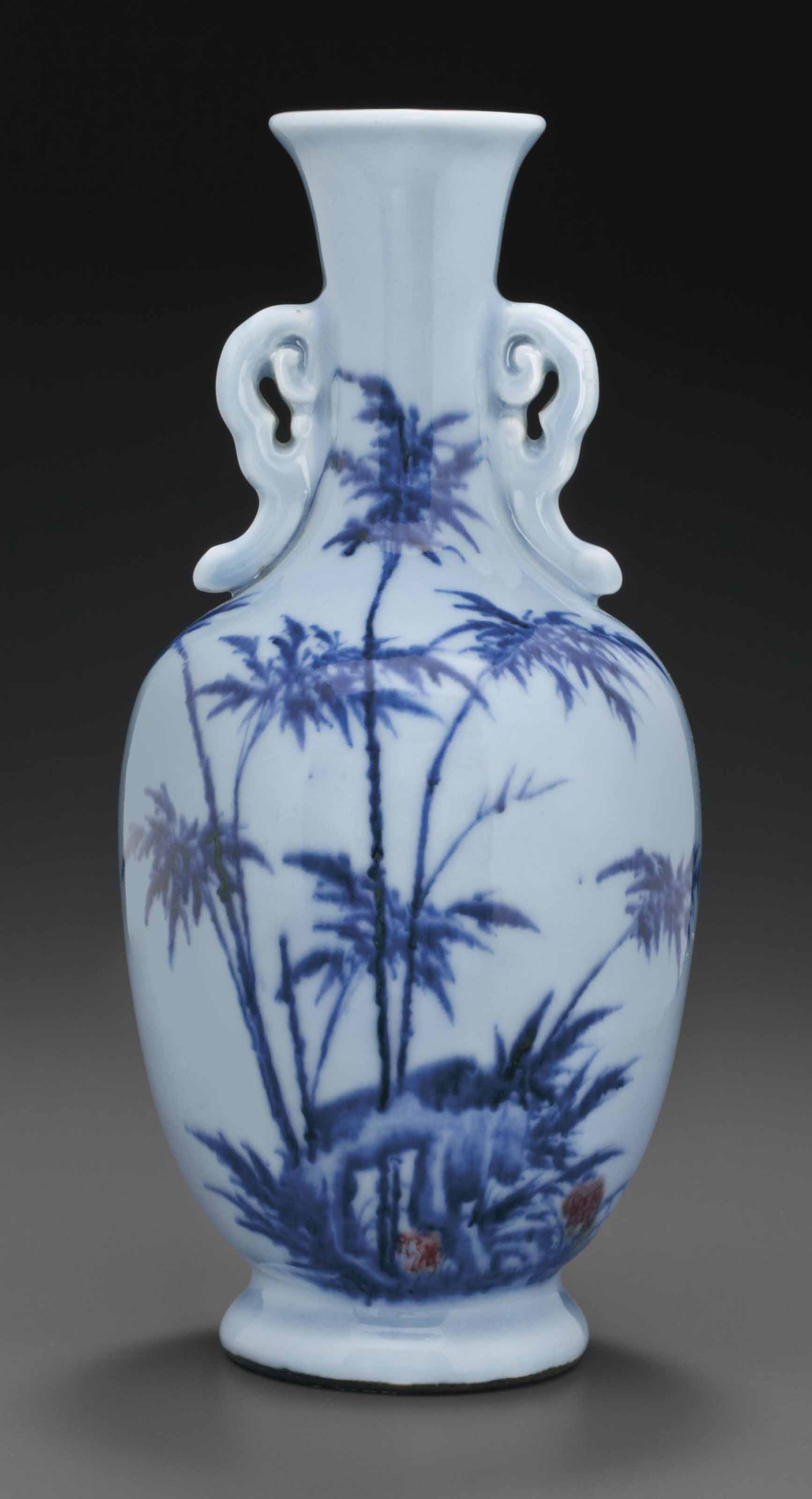 AN UNDERGLAZE BLUE AND COPPER-RED-DECORATED PALE BLUE VASE