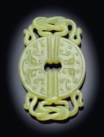 A YELLOW JADE BI-FORM PENDANT