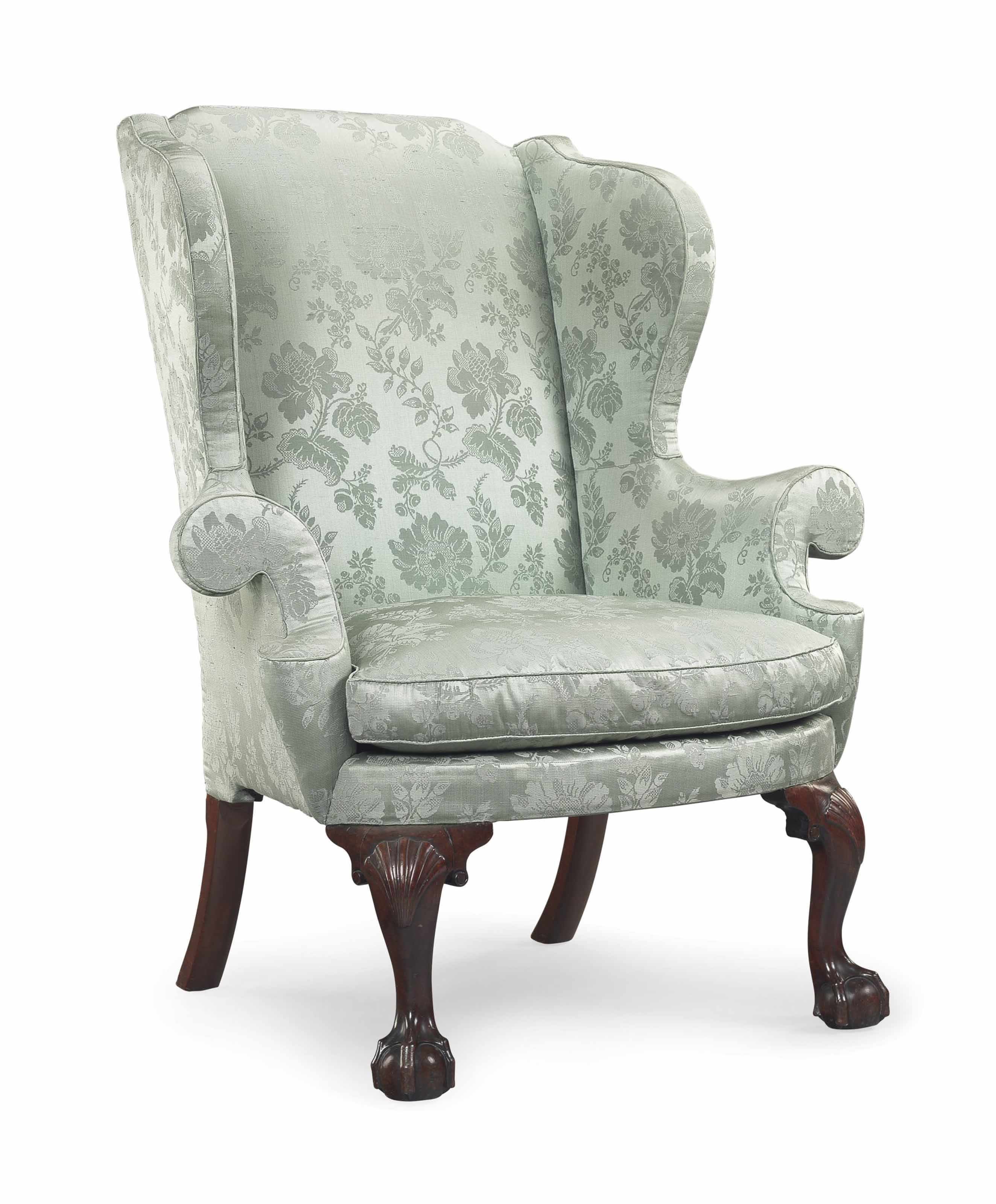 A CHIPPENDALE CARVED MAHOGANY EASY CHAIR