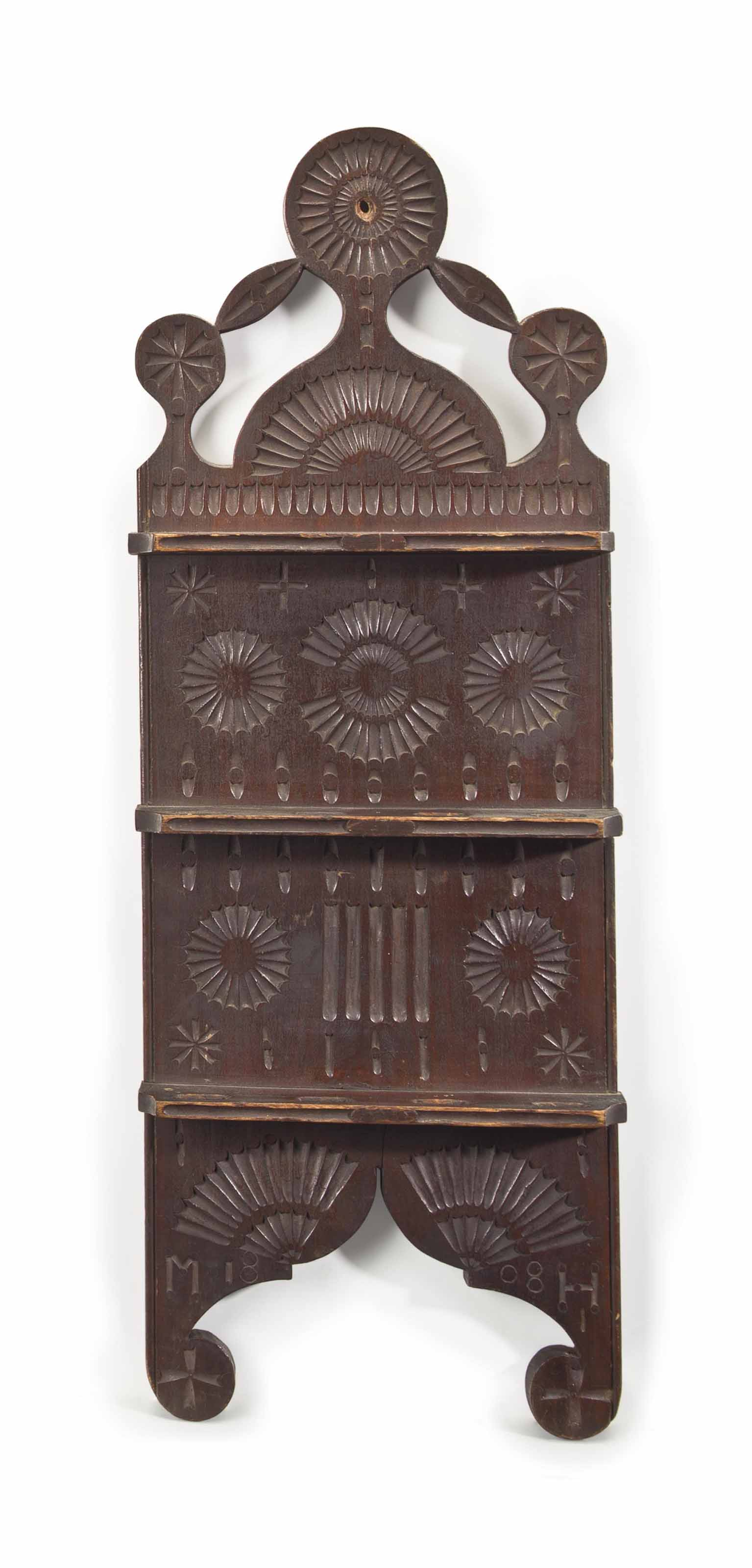 A red stained and chip carved poplar spoon rack possibly