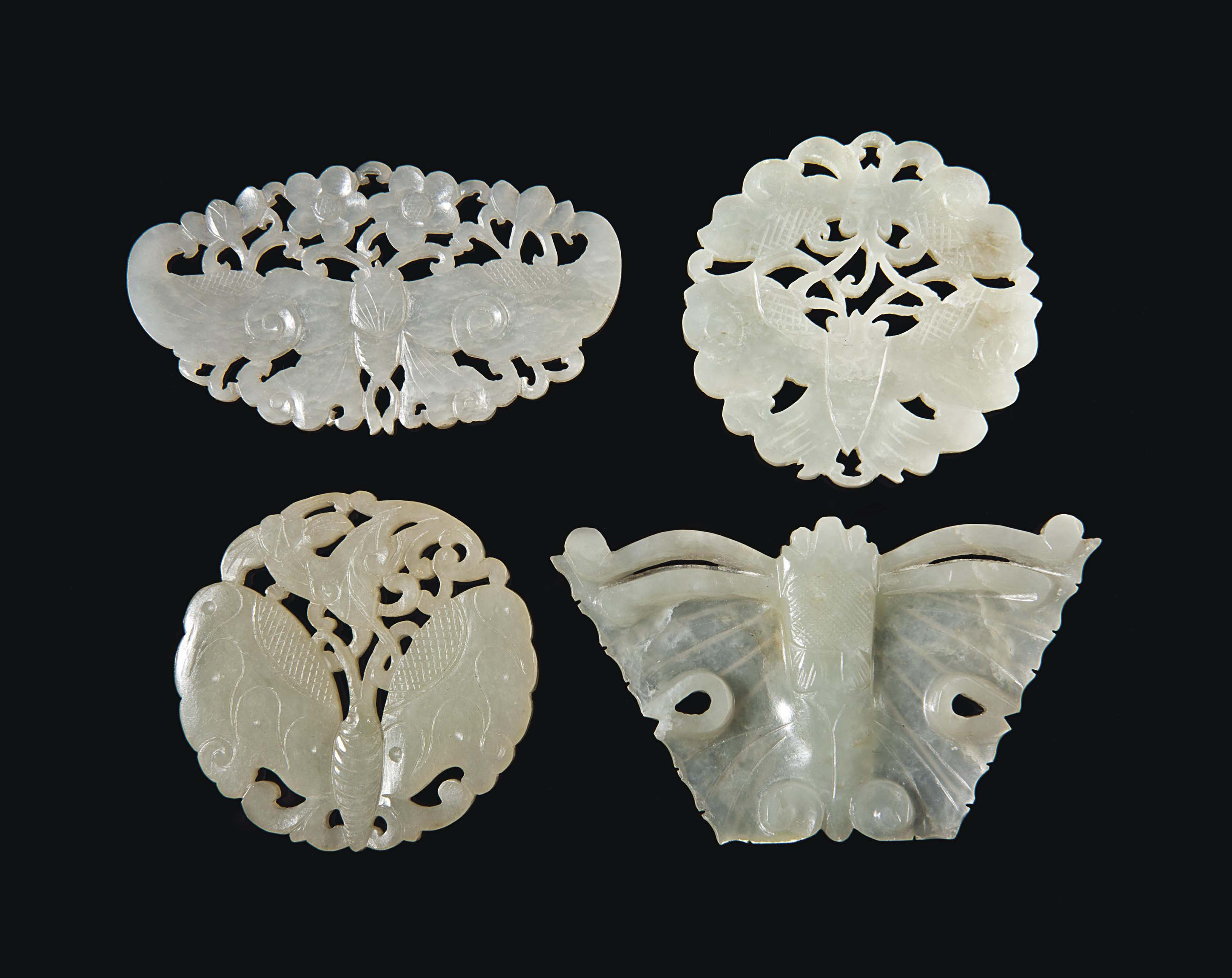 FOUR CHINESE CELADON JADE PIERCED 'BUTTERFLY' PLAQUES,