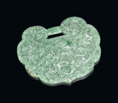 A CHINESE MOTTLED GREEN JADEIT