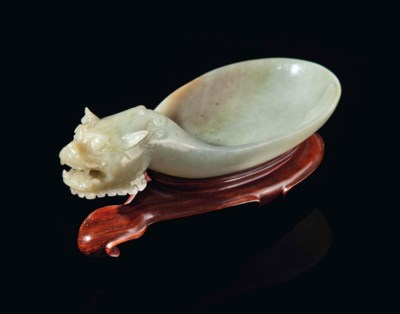 A CHINESE CELADON JADE SCOOP,