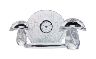 A FRENCH MOLDED GLASS DESK CLO