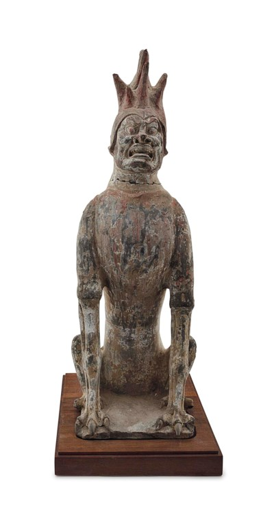 A CHINESE GREY POTTERY FIGURE