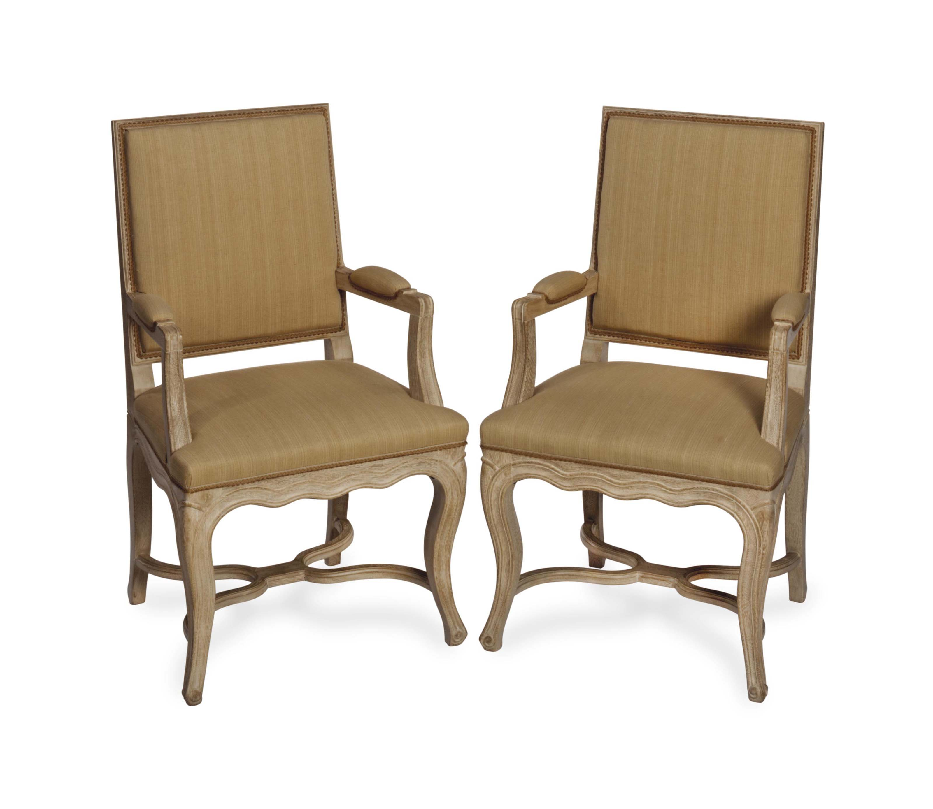 A PAIR OF LOUIS XV STYLE LIMED OAK FAUTEUILS COVERED IN BEIGE LINEN,
