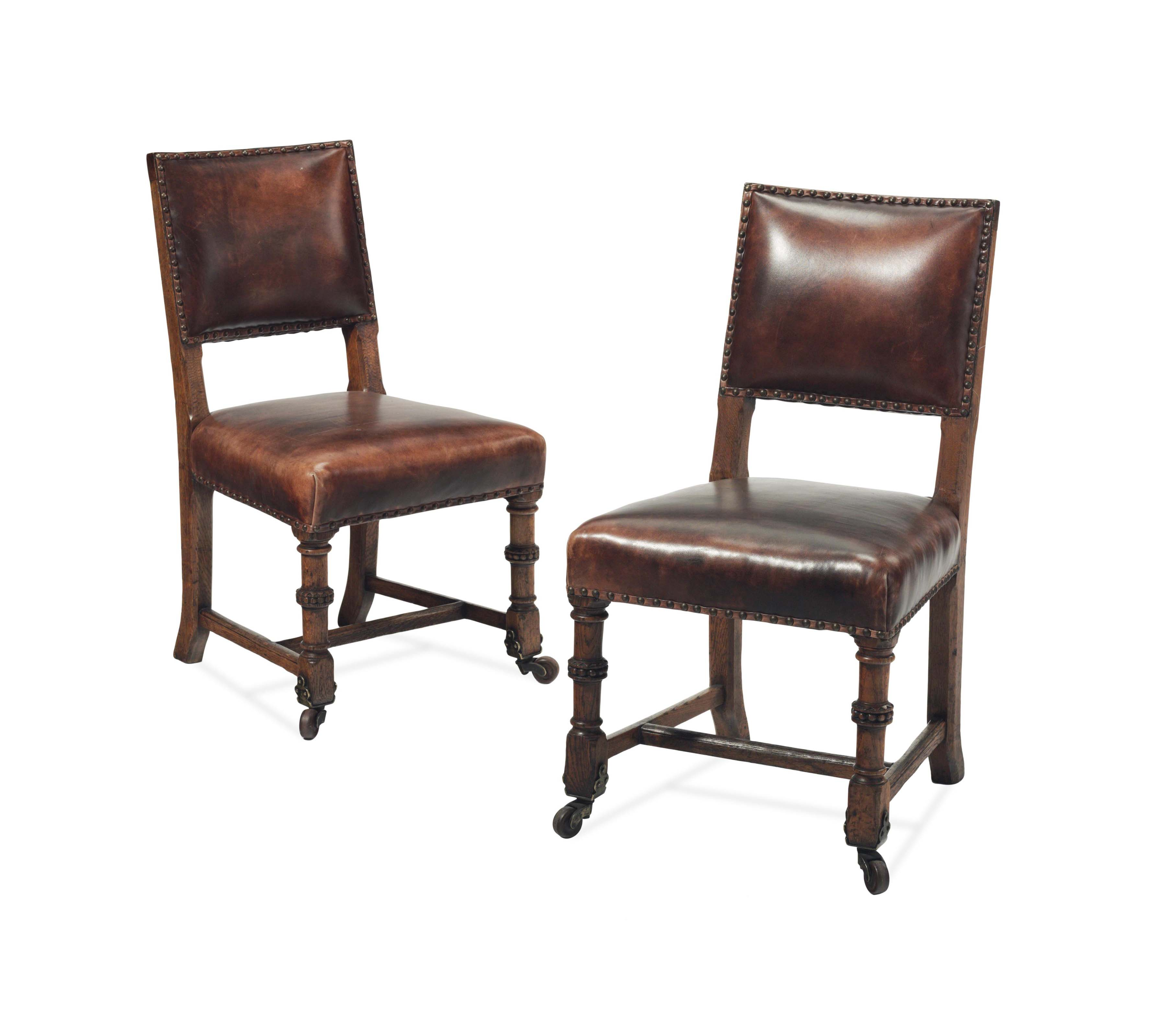 A SET OF NINE ENGLISH ARTS AND CRAFTS OAK LEATHER-UPHOLSTERED DINING CHAIRS,