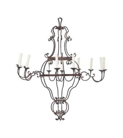 A WROUGHT IRON TWELVE-LIGHT CH
