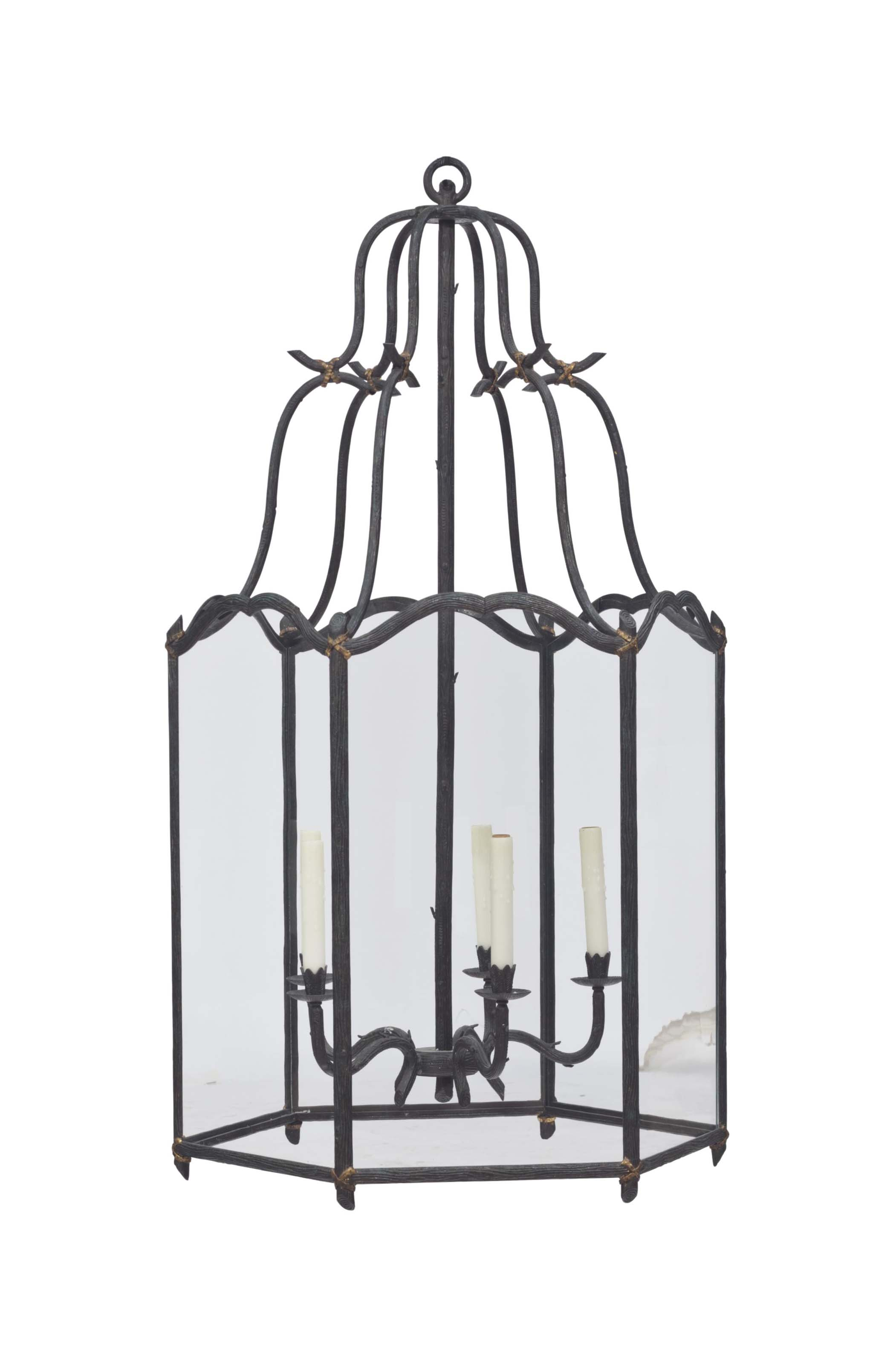 A WROUGHT IRON AND PARCEL GILT FIVE-LIGHT LANTERN