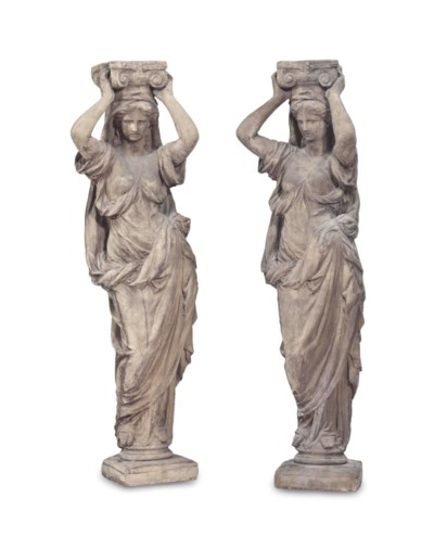 A PAIR OF COMPOSITION STONE AR