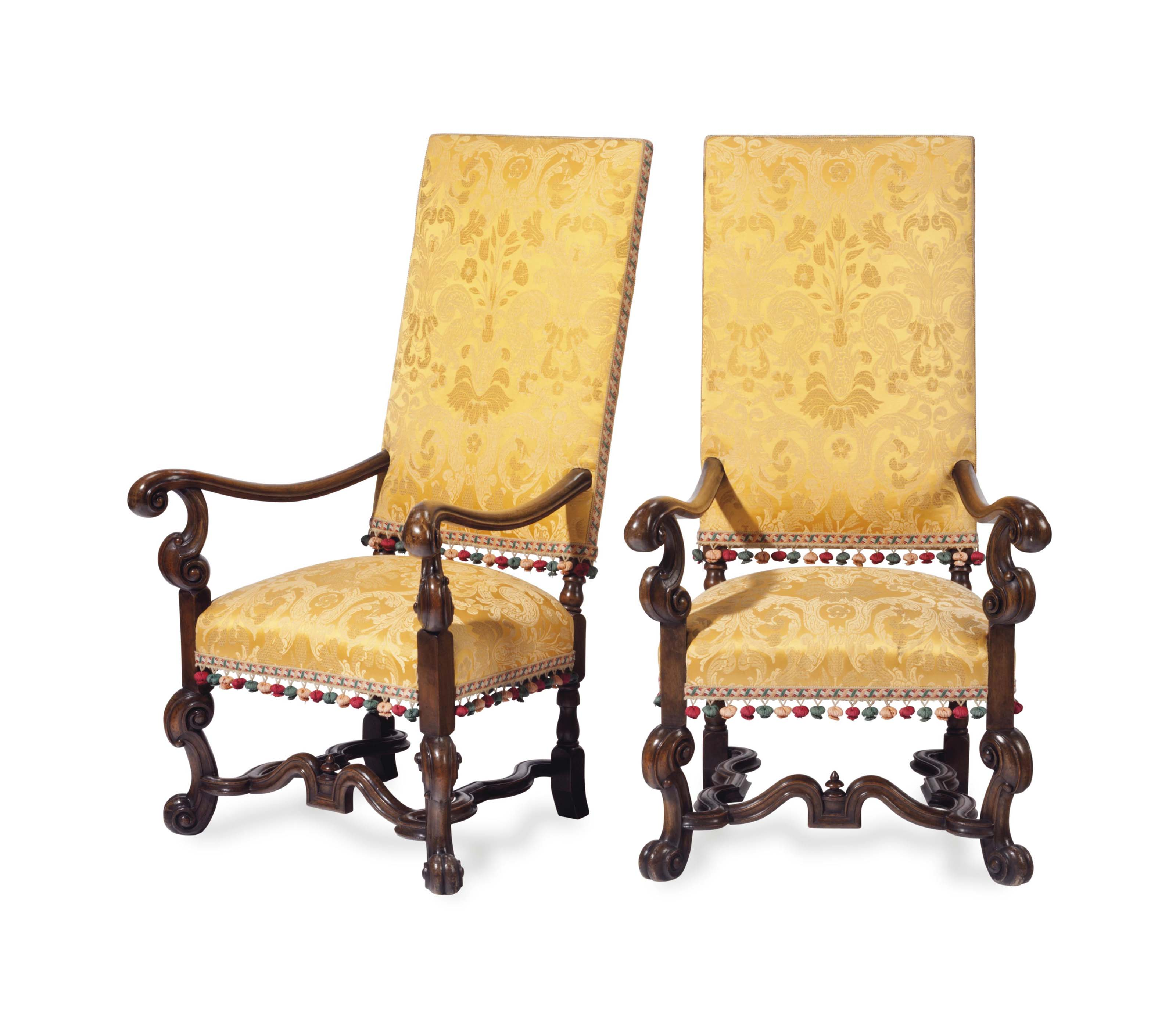A SET OF FOUR BAROQUE STYLE WALNUT OPEN ARMCHAIRS COVERED IN YELLOW SILK DAMASK