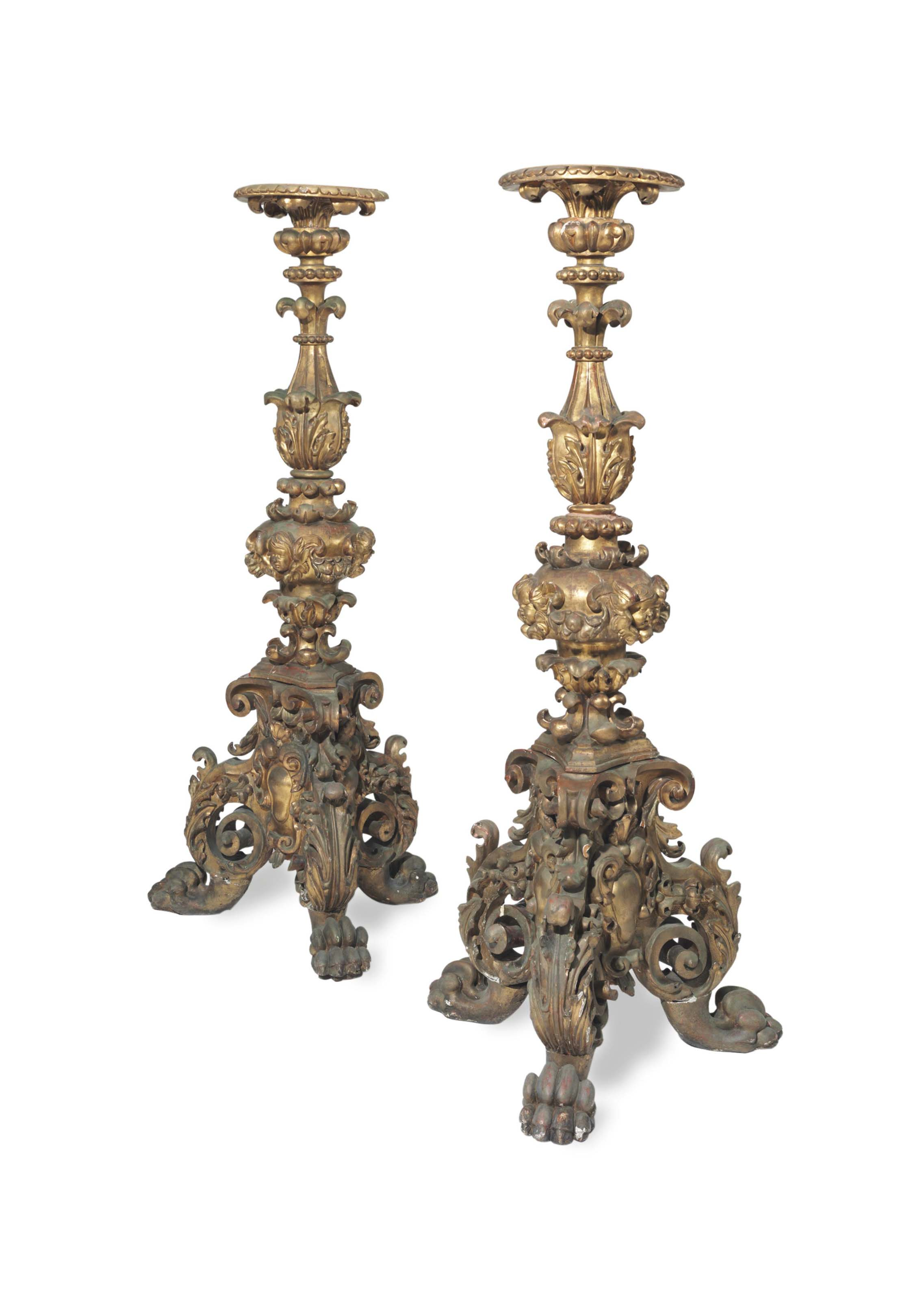 A PAIR OF BAROQUE STYLE GILTWOOD TORCHERES,
