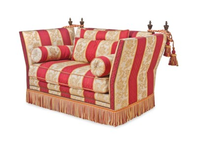 AN UPHOLSTERED KNOLE TYLE SOFA