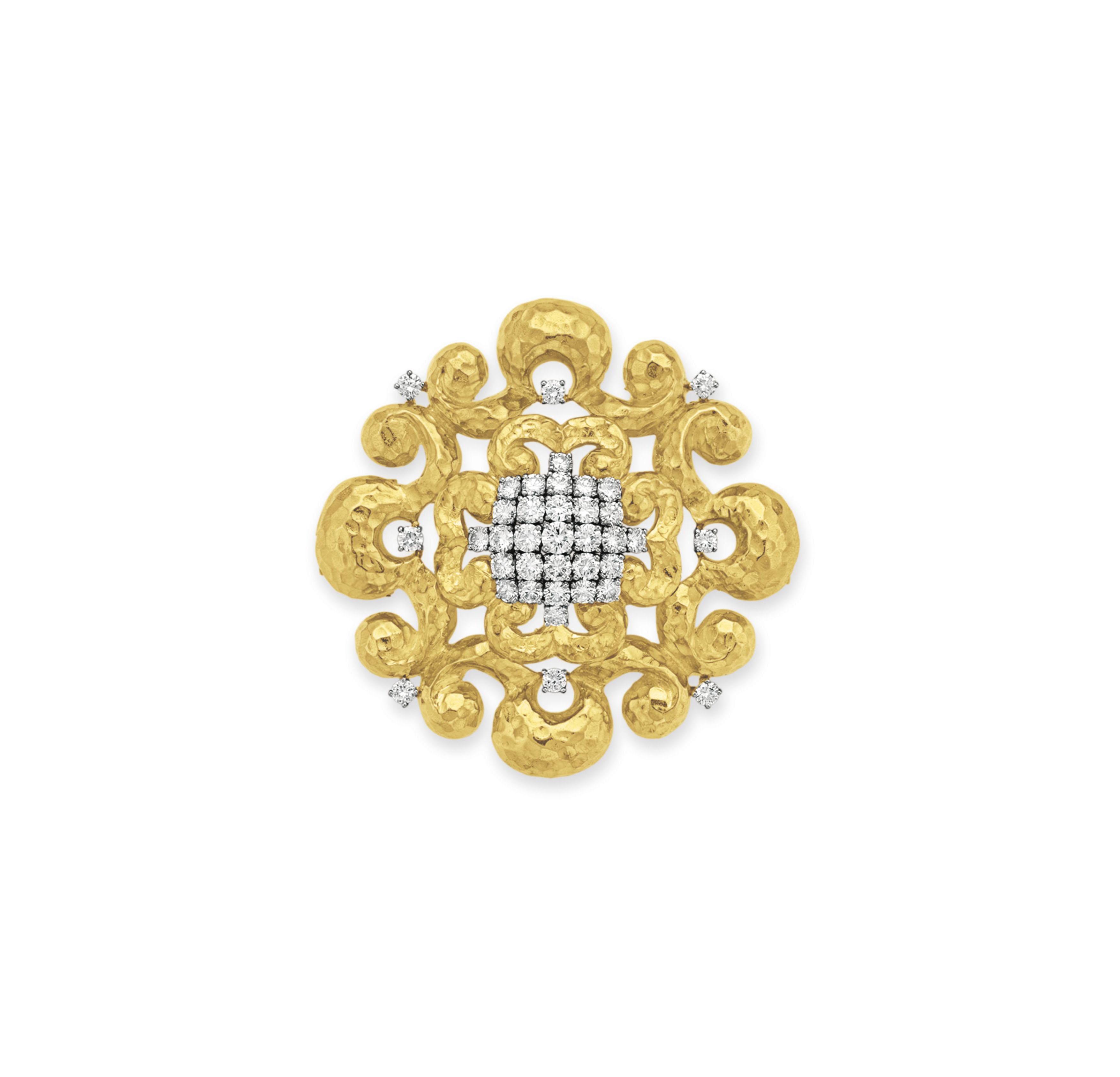 A DIAMOND AND GOLD PENDANT BRO