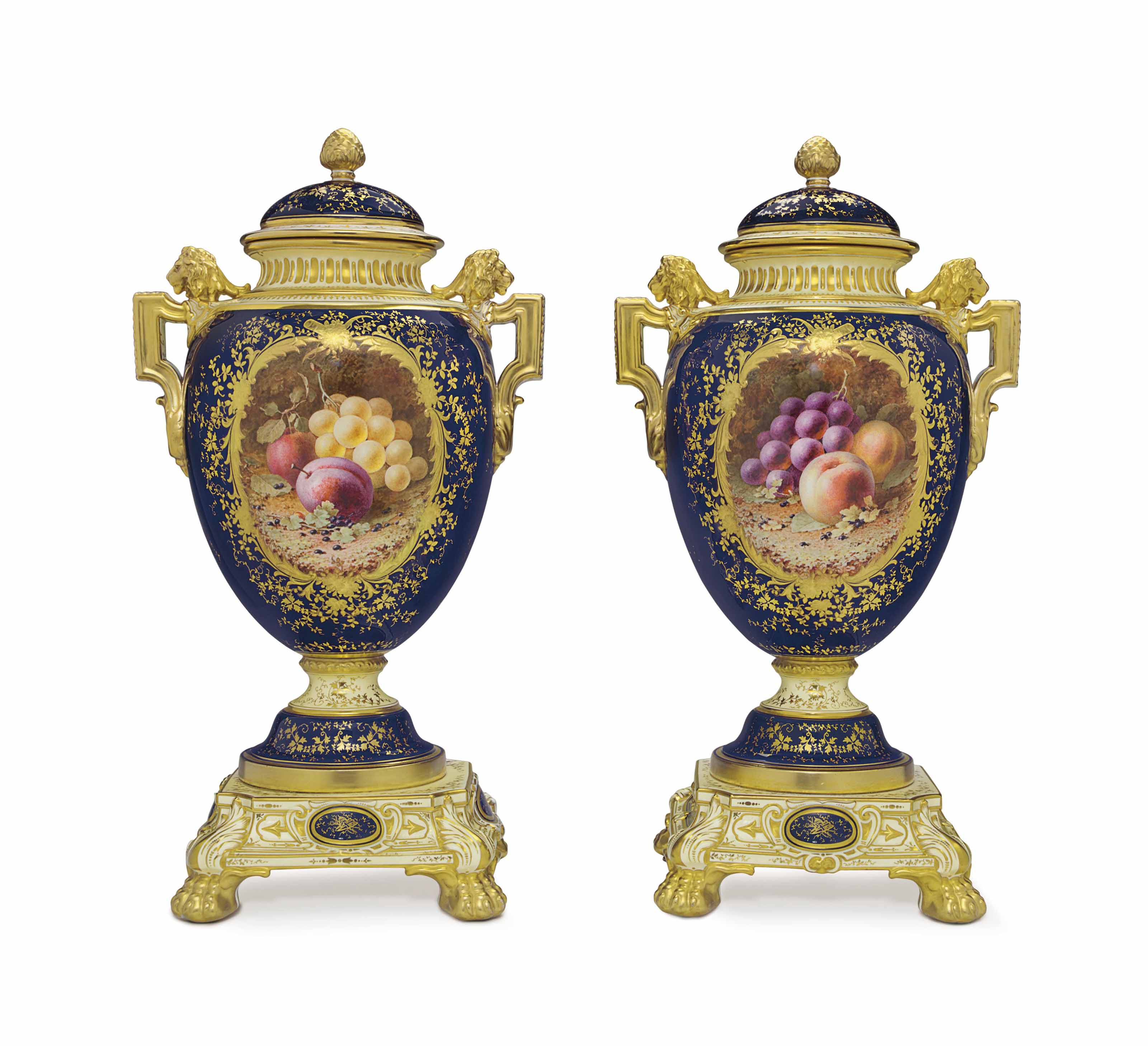 A PAIR OF COALPORT PORCELAIN PALE-YELLOW AND COBALT-BLUE GROUND VASES AND COVERS, ON FIXED STANDS