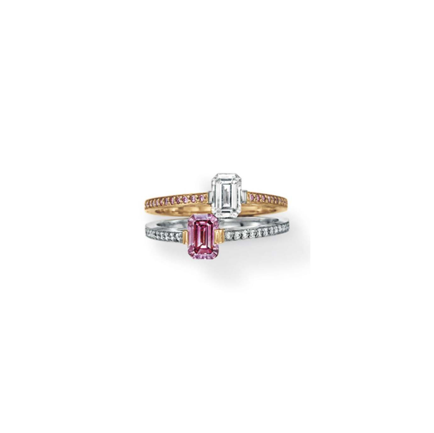A COLORED DIAMOND AND DIAMOND TWO-STONE RING