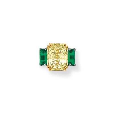 A YELLOW SAPPHIRE AND EMERALD