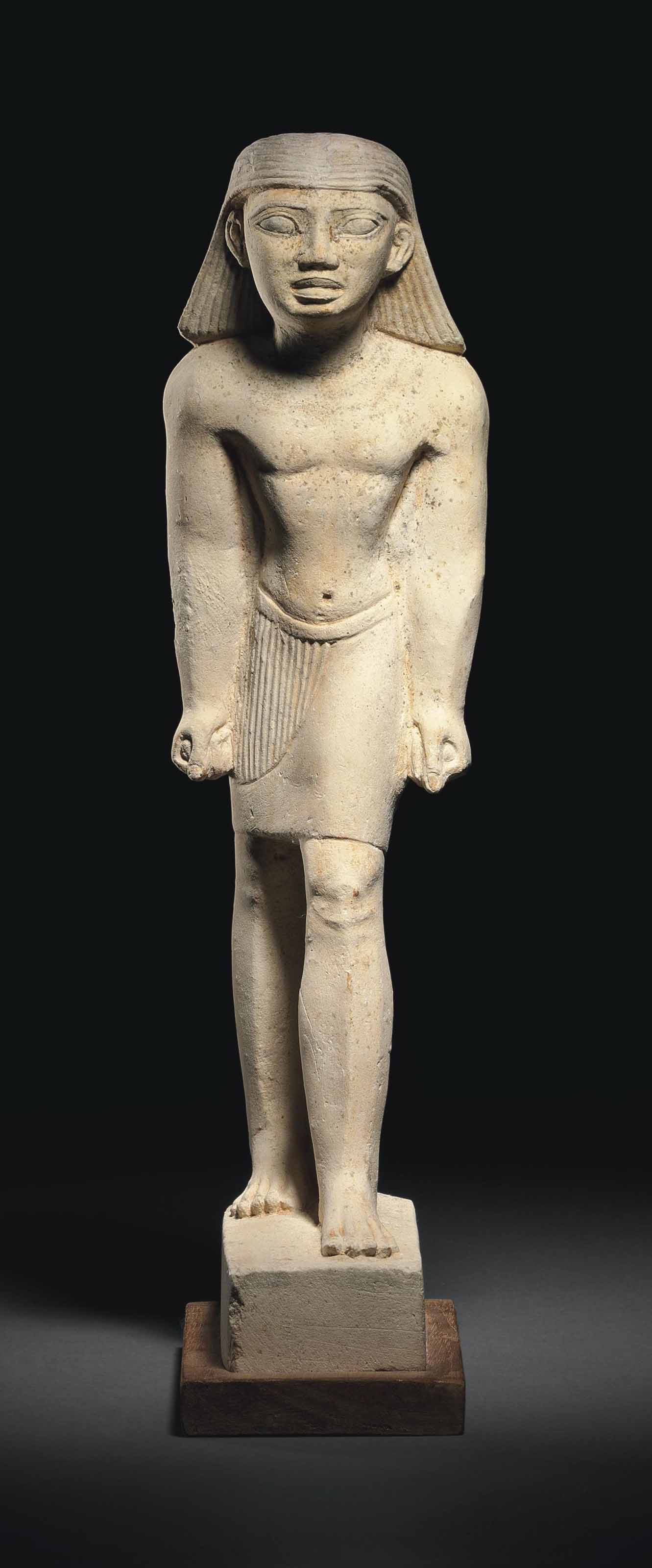An egyptian limestone figure of a man old kingdom th