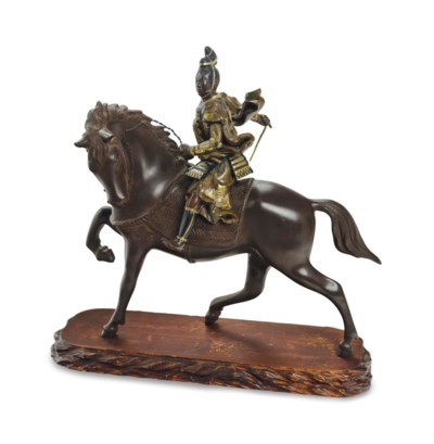 A JAPANESE BRONZE MODEL OF AN