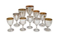 A GROUP OF EIGHT ENGLISH SILVER AND SILVER-GILT GOBLETS