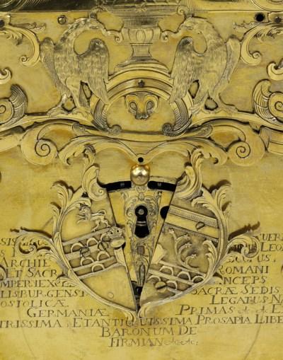 AN AUSTRIAN GILT-COPPER WRITIN