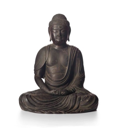 A BRONZE FIGURE OF THE SEATED