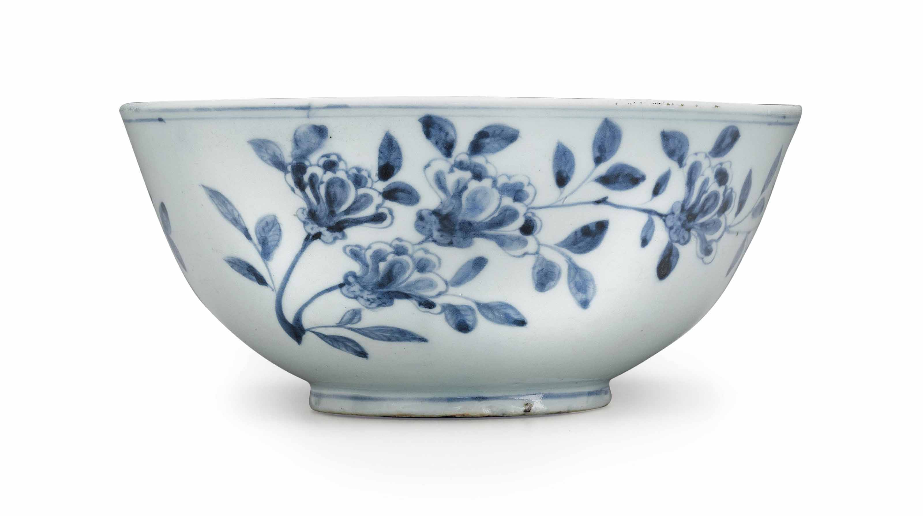 A blue and white porcelain bowl with flower design for Decorating with blue and white pottery
