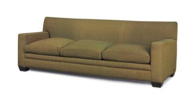 A GREEN SILK COVERED SOFA