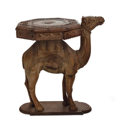 A CARVED CAMEL-FORM OCCASIONAL