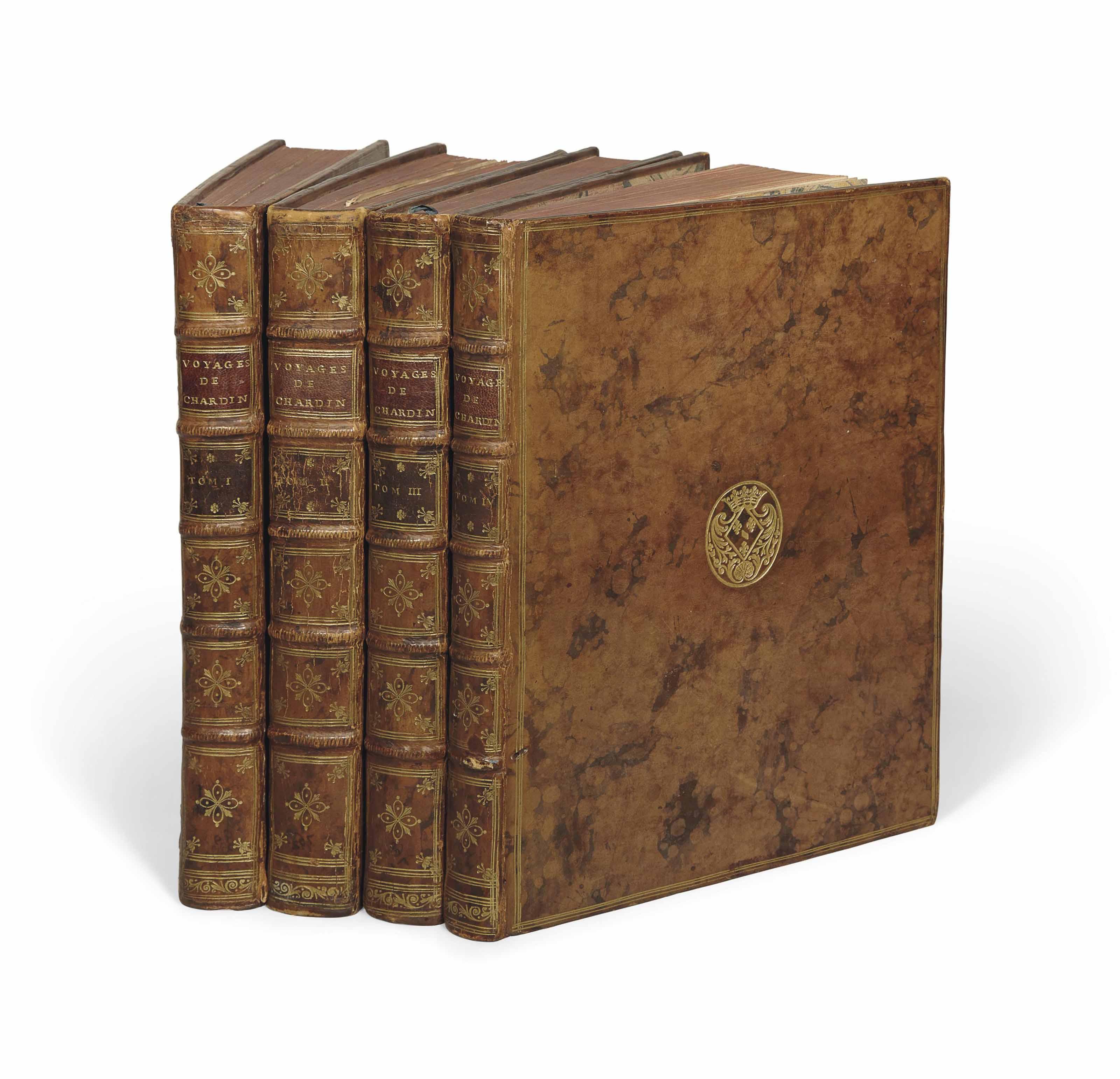 CHARDIN, Jean (1643-1713). Voyages en Perse, et autres lieux de l'Orient. Nouvelle édition, augmentée du couronnement de Soliman II. Amsterdam : La compagnie, 1735. 4 volumes in-4 (257 x 192 mm). 2 frontispices répétés (volumes I et III) avec le portrait de l'auteur par Tomassin, 78 planches gravées (numérotées de 1-79, le n° 78 est omis) dont une carte et des vues, planches de costumes, moeurs, etc., 5 vignettes. Reliure de l'époque, veau marbré de l'époque, armes de Louise-Anne de Bourbon-Condé (OHR 2630) frappées au centre des plats, triple filet doré en encadrement, dos à nerfs ornés.