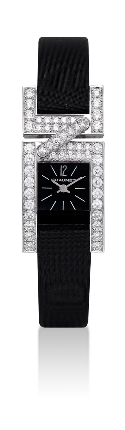 CHAUMET. A LADY'S 18K WHITE GO