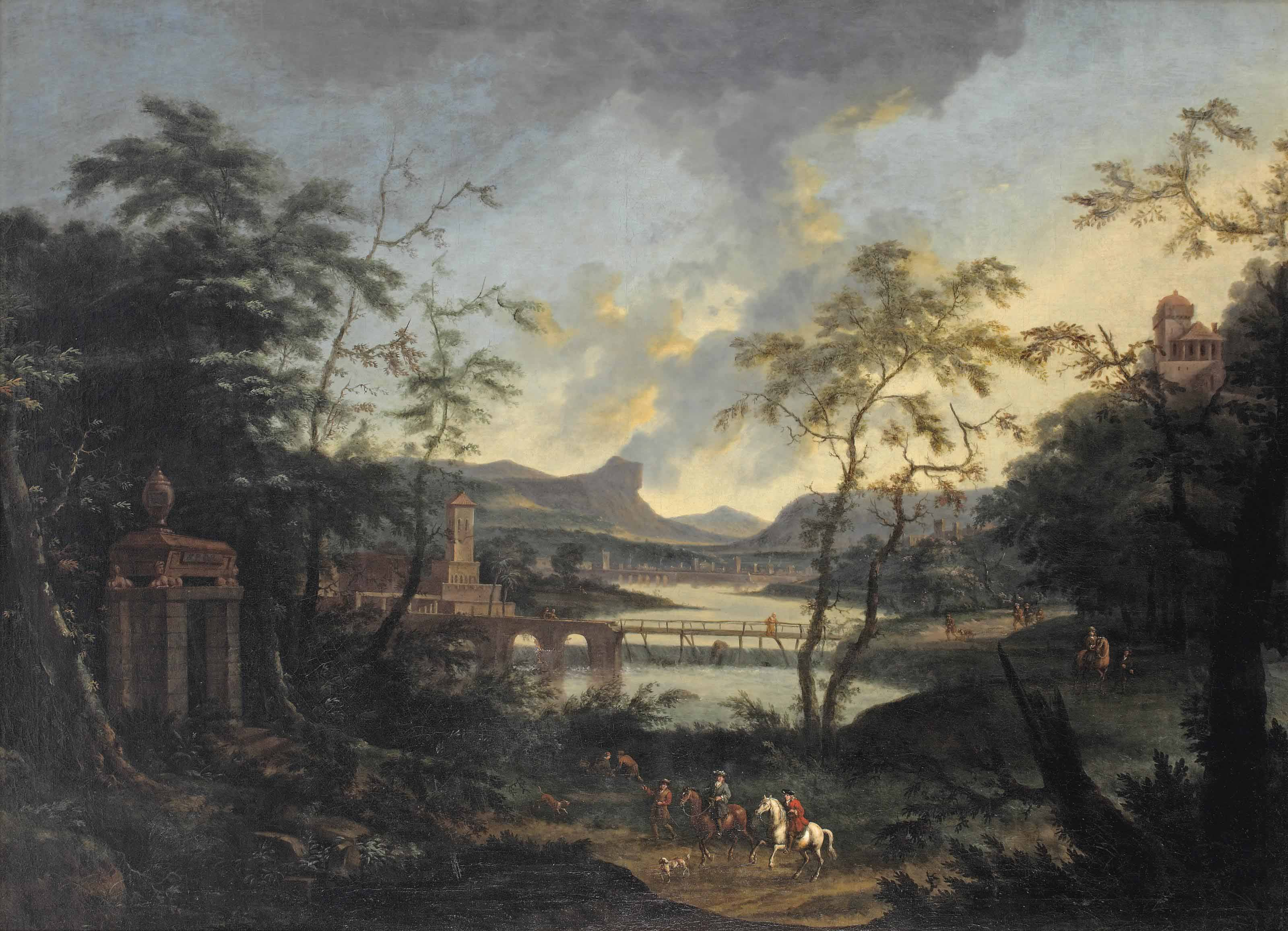 An Italianate river landscape with two equestrian figures, peasants and dogs on a wooded path, a town beyond