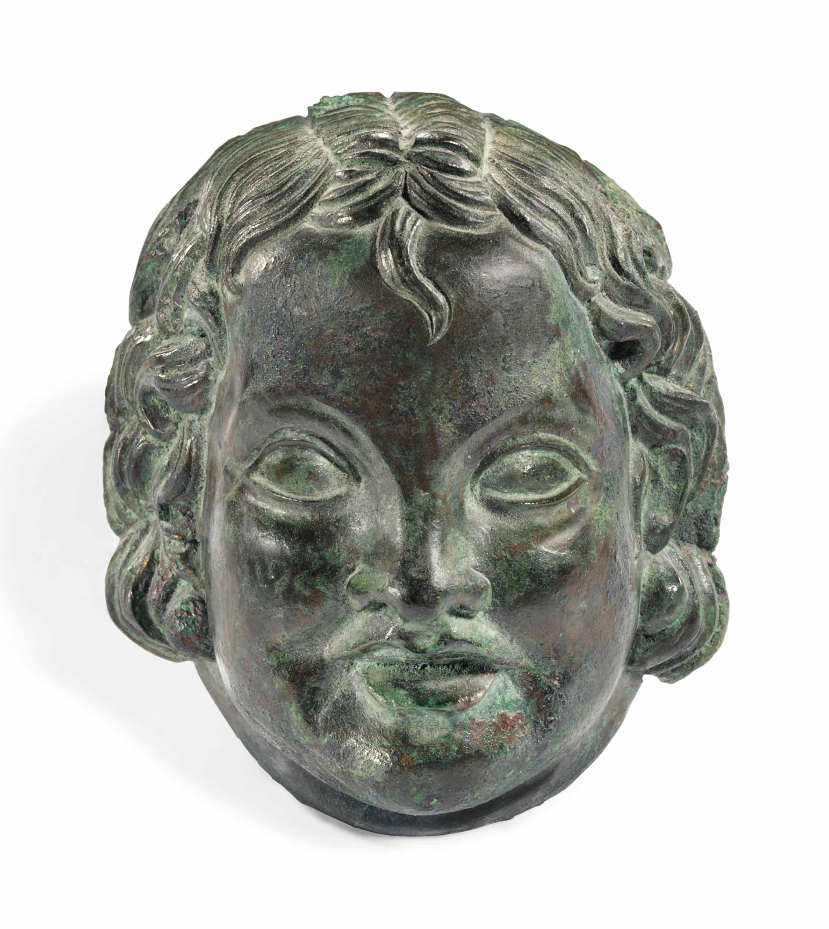 A ROMAN BRONZE HEAD OF CUPID