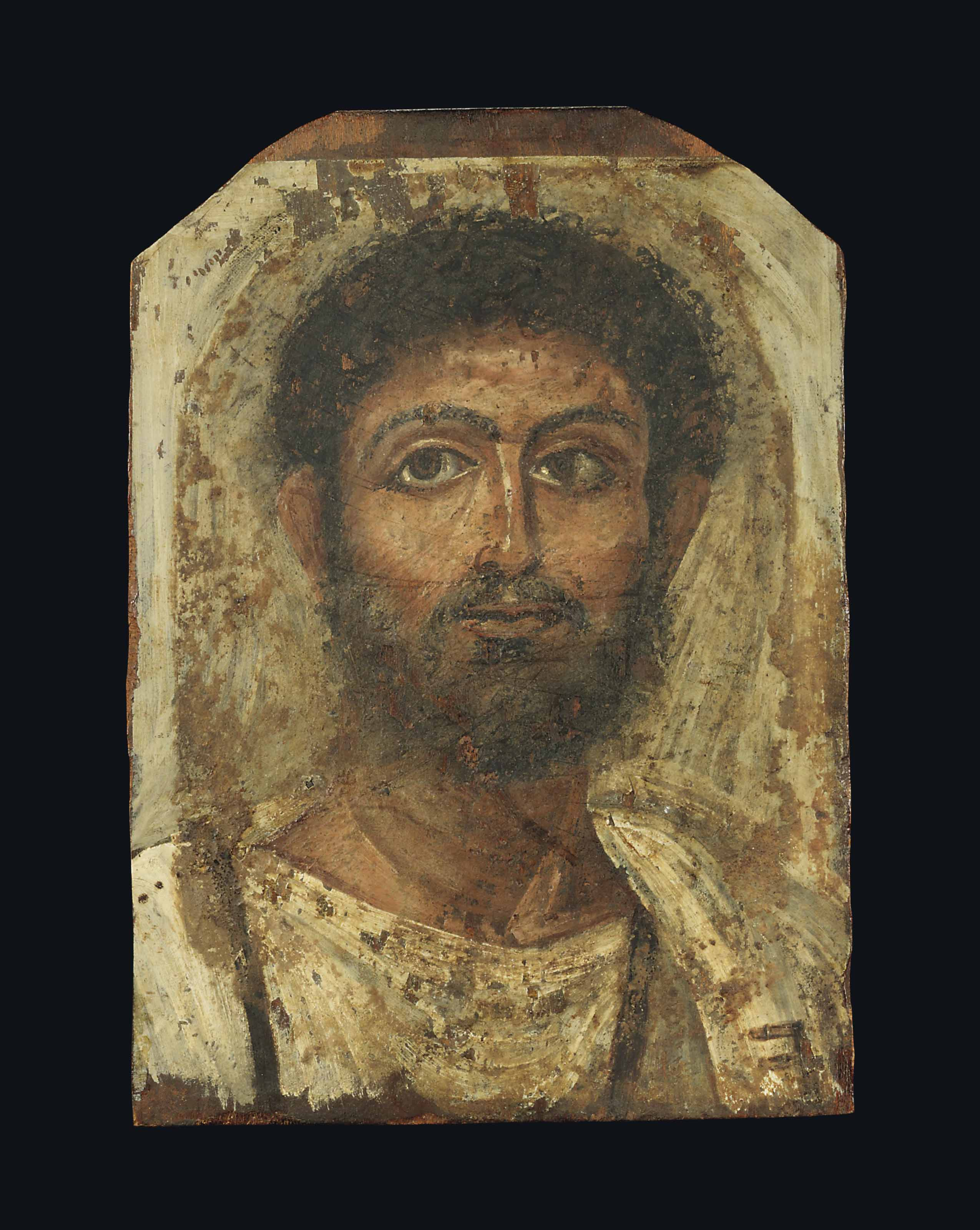 AN EGYPTIAN PAINTED WOOD MUMMY PORTRAIT OF A MAN