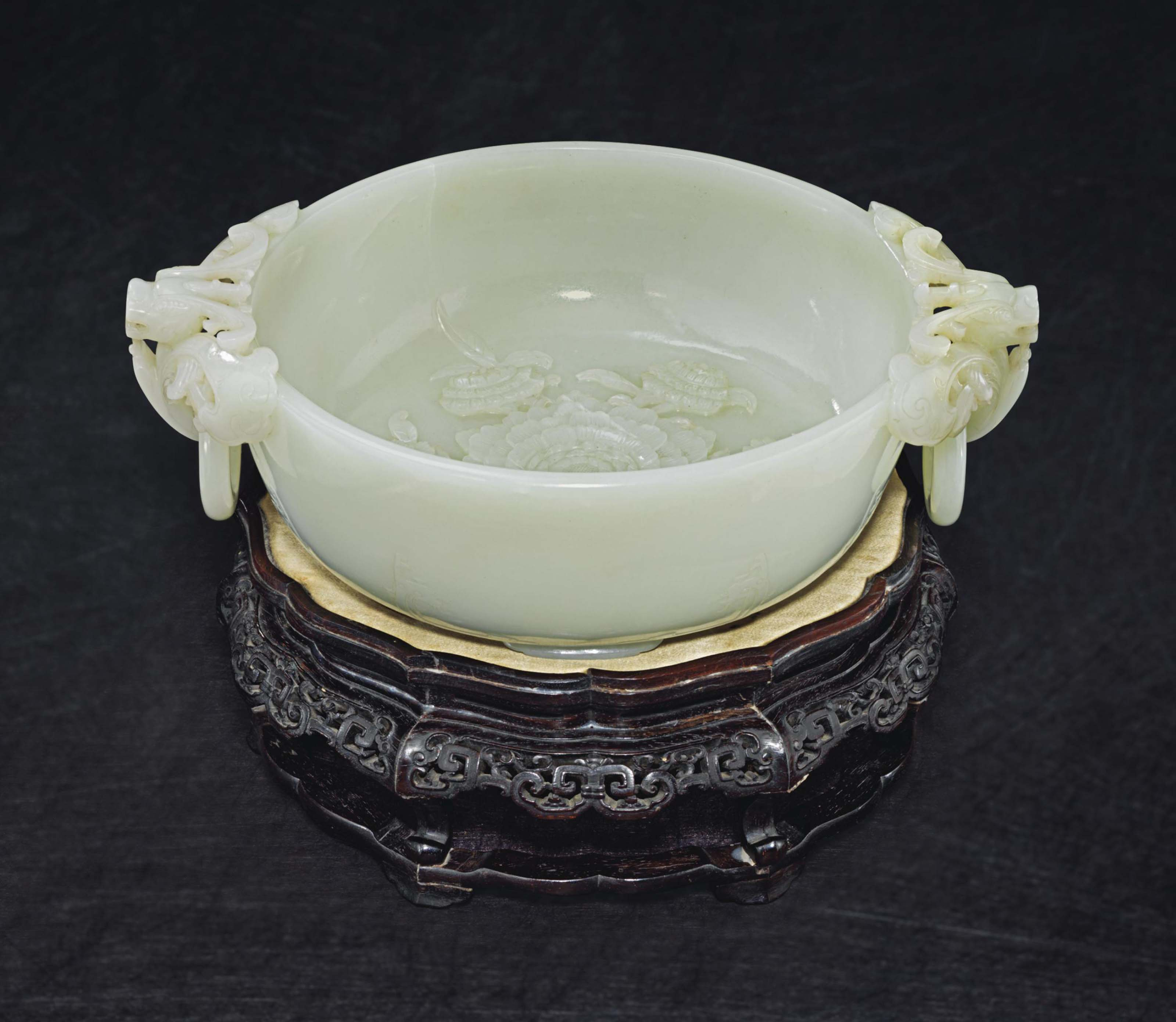 A RARE AND FINELY CARVED WHITE JADE MARRIAGE BOWL AND A CARVED ZITAN STAND