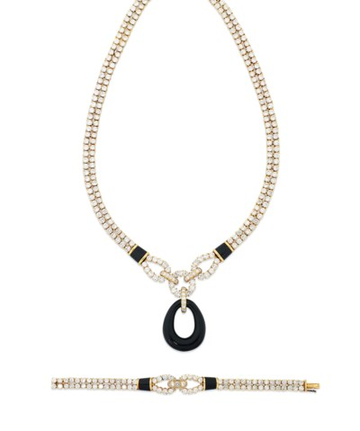 AN ONYX AND DIAMOND NECKLACE A