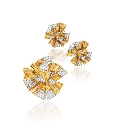 AN 18 CARAT GOLD AND DIAMOND B