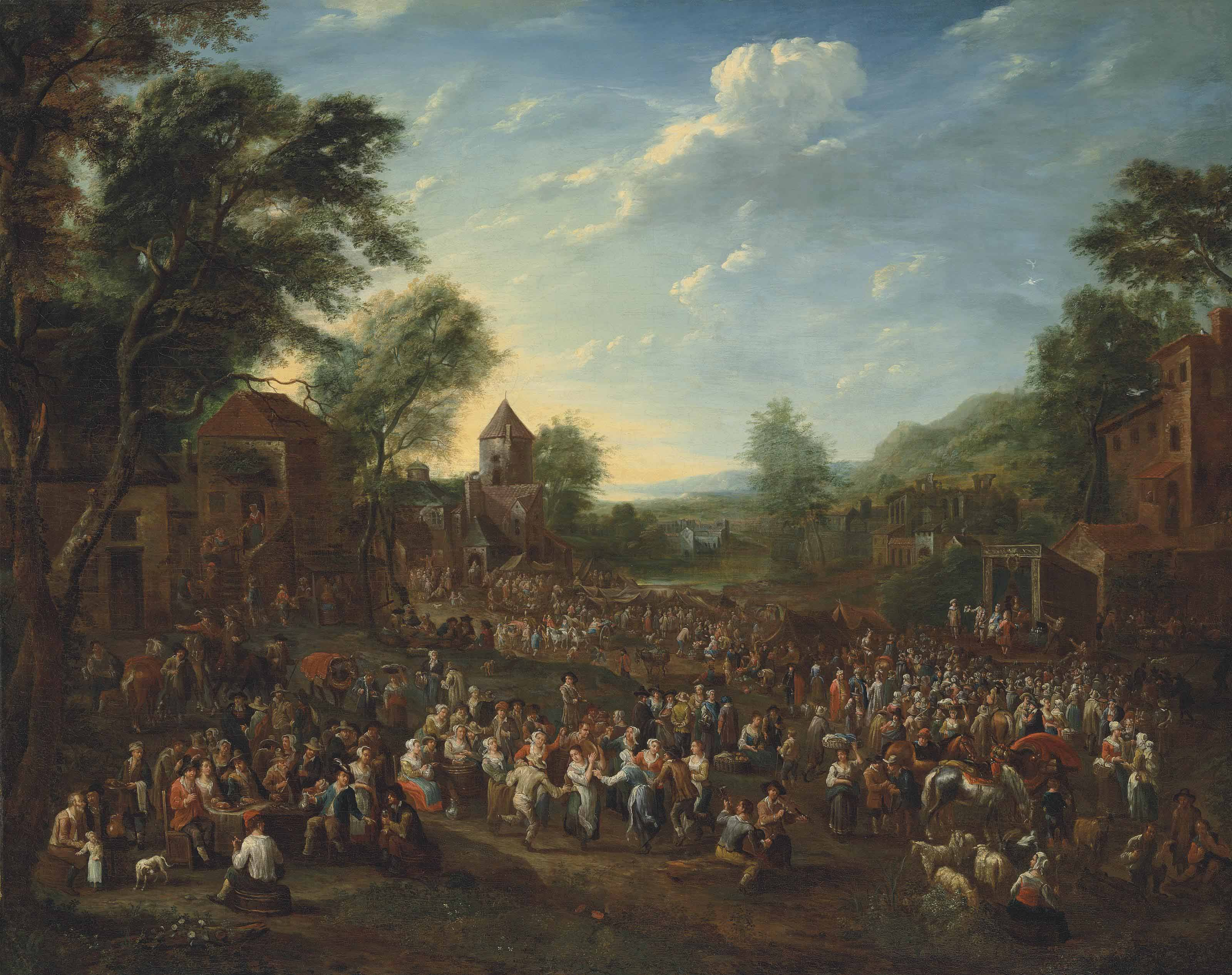 A village kermesse with revellers dancing and making merry