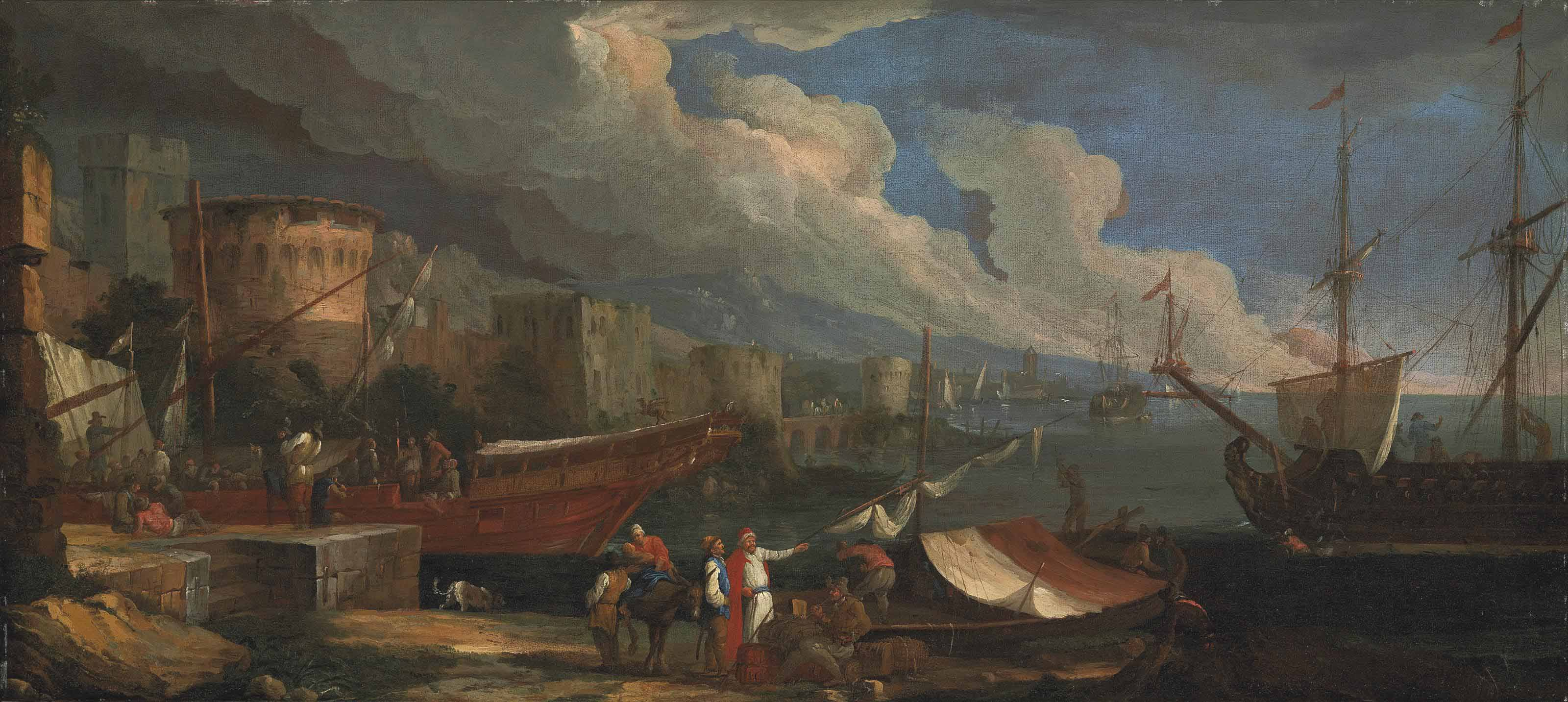 A coastal landscape with figures conversing on the harbour and anchored ships beyond