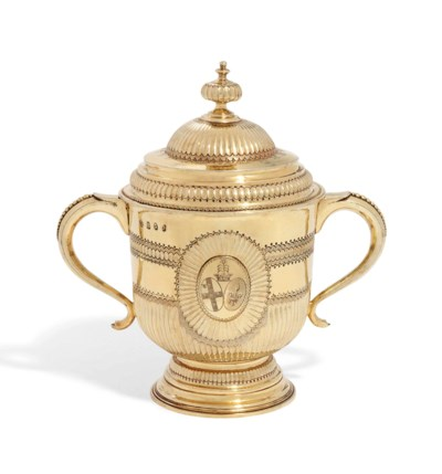 A QUEEN ANNE SILVER-GILT CUP A