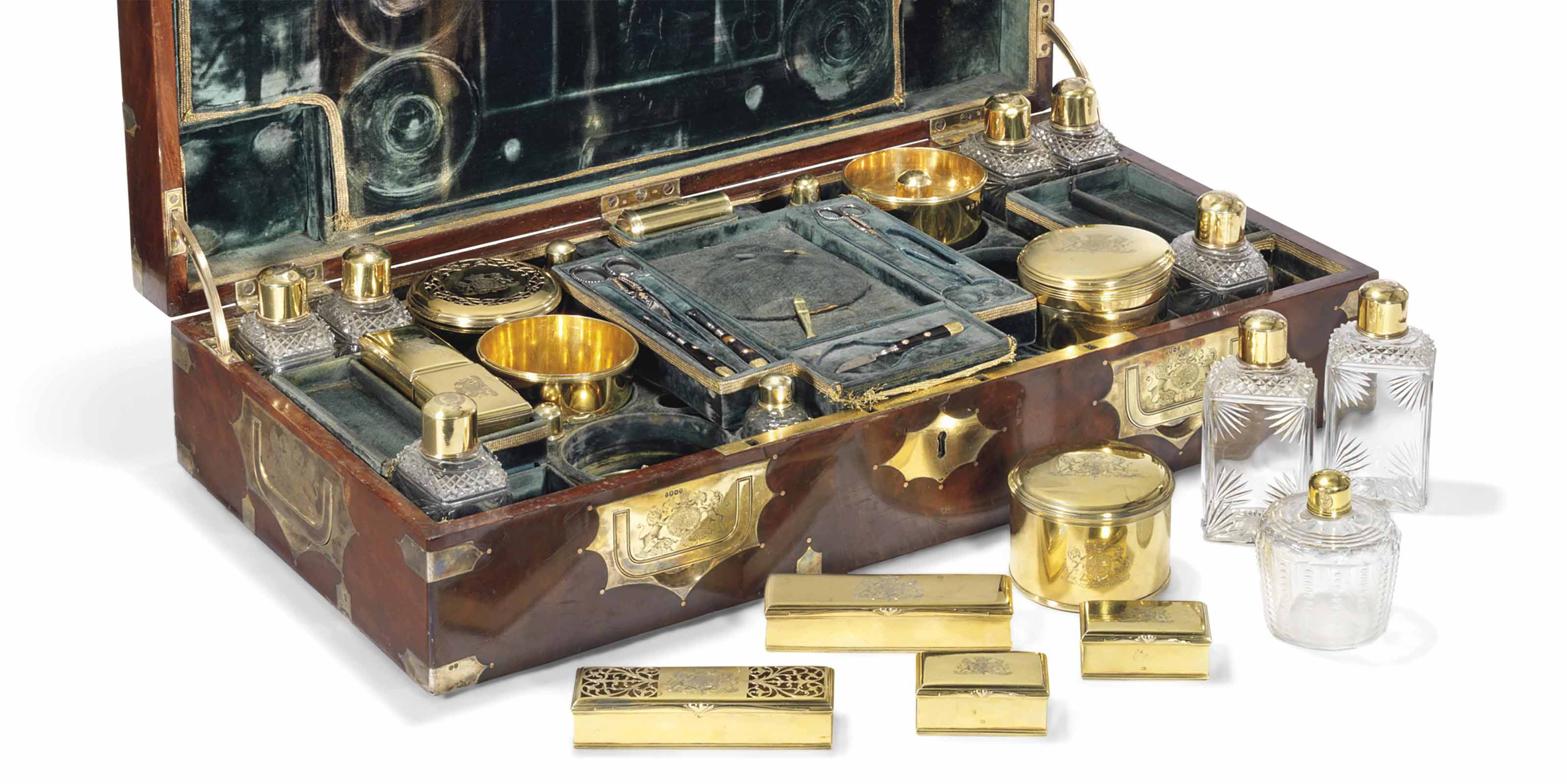 A GEORGE III SILVER-GILT TRAVE