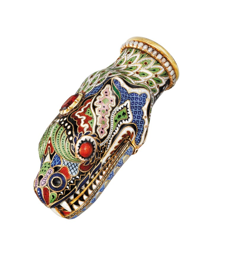 A Swiss jewelled, enamelled gold vinaigrette, Geneva, circa 1830. 3 in (70  mm) high. Sold for £37,500 on 1-2 December 2015 at Christie's in London